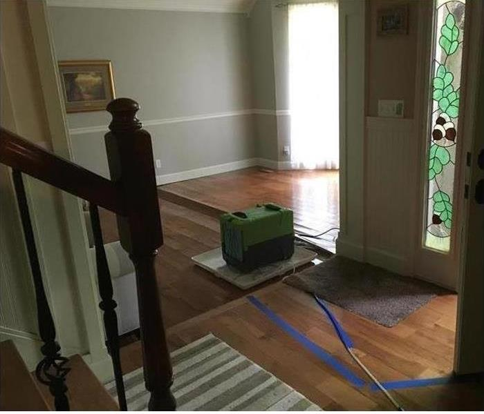 buckled flooring planks with a dehumidifier
