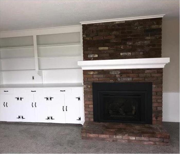 bricks, mantle, and white cabinets cleaned and fresh looking