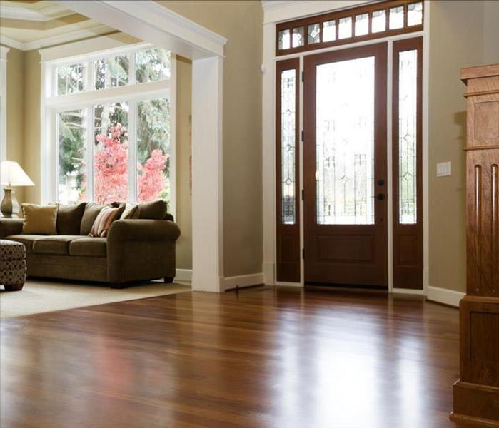 View of the foyer of a home with hardwood flooring